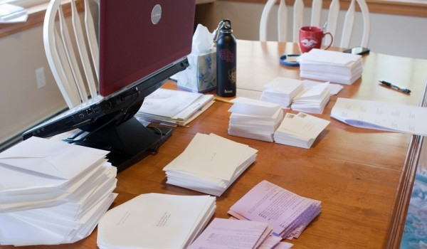 Picture of a lot of envelopes on the table.